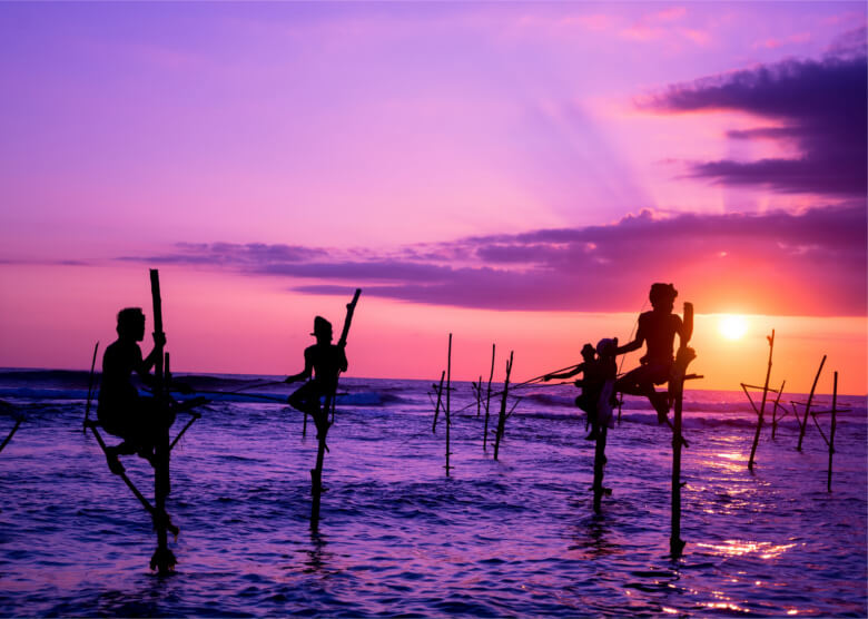 Fischer im Sonnenuntergang bei Mirissa